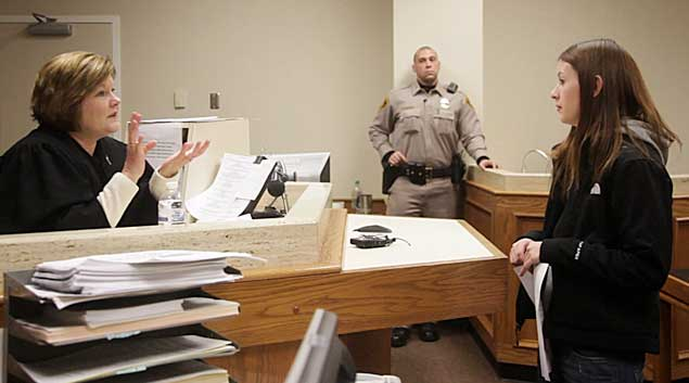 Emily Linville talks with Judge Sarah Smith's inside her courtroom in downtown Tulsa on Jan. 10, 2011. After two years of being clean, Linville will graduate drug court next month. Linville fought an addiction to Lortab pills and was caught and given the option of attending treatment and drug court.