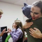 Amy Cassell hugs her daughter, Haley, 16, following the performance of A Center Point Holiday at the facility in north Tulsa. The holiday play was written, organized and performed by the 33 women in the program for their families and friends. Center Point in Tulsa provides therapeutic recovery for incarcerated women with drug and alcohol addictions.