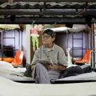 Jo Ann Baker sits on her bunk reading at Eddie Warrior Correctional Center on Dec. 1, 2010.