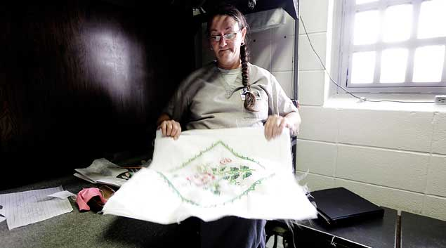 Alma Steele works on a needle point project at Eddie Warrior Correctional Center Dec. 1, 2010.