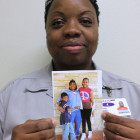 Lasonya Davis, 36, posing inside Taft's Eddie Warrior Correctional Center with a photo of her children Tatyana, 12, and Sir Terrance, 8. She said her parental rights were terminated in 2006.