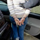 Tulsa Police Det. Andrew Mackenzie takes Kristy Rene Wade into custody as Tulsa Police Officers serve an arrest warrant Dec. 22, 2010.