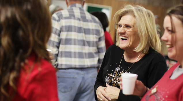 Jeanine Bezotte jokes around at the Exodus House Christmas party at St. Luke's United Methodist Church in North Tulsa on Dec. 14, 2011. Bezotte spent time in prison for drug crimes, but now works at Exodus House, which helps offenders transition into life after incarceration.