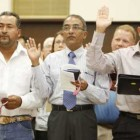 Former Mexican citizen Ernesto Rosas (left) and former Indian citizens Simon Mascarenhas and George Varghese take the oath of U.S. citizenship during a June 24 naturalization ceremony at the federal courthouse in Oklahoma City.