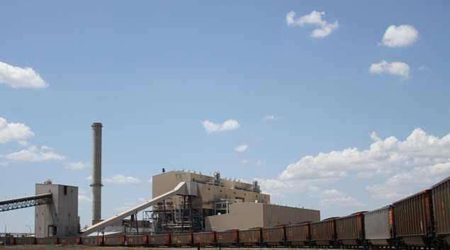 A line of boxcars delivers coal to the AES Shady Point power plant near Spiro. Insurance companies claimed almost $56 million in tax credits under the Oklahoma Coal Production Incentive Act between 2004 and 2011.
