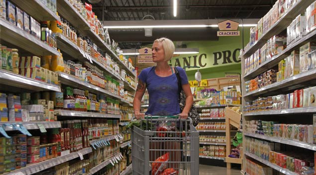 Jade Rennels, a Norman food stamp recipient is shopping at Natural Grocers, which sells natural and organic grocery items.