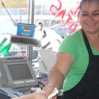 Lupe Azua assists a customer at Mora's Market in downtown Guymon.