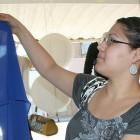Solia Medina examines the merchandise at Frida, a Hispanic-owned clothing store.