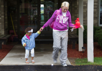 U.S. Army veteran Briana Hawkes, 25, picks up her daughter Aubrey, 3, from Champion Day School in Warren, Ohio. Hawkes was deployed to Kandahar, Afghanistan in April 2012, just months before Aubrey's second birthday.