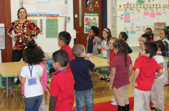 """Lee Elementary School pre-kindergarten teacher Victoria Tsaras gets active with her students, dancing to """"What Does the Fox Say?"""""""