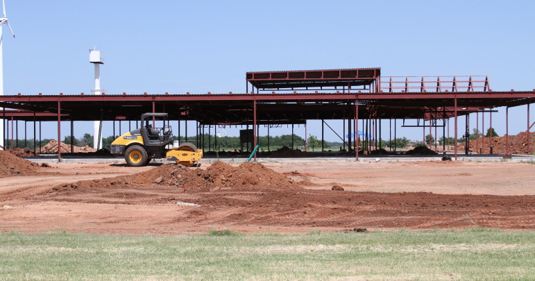 Construction crews work to rebuild at the Canadian Valley Technology Center in El Reno. The school was hit by an EF-3 tornado on May 30, 2013.