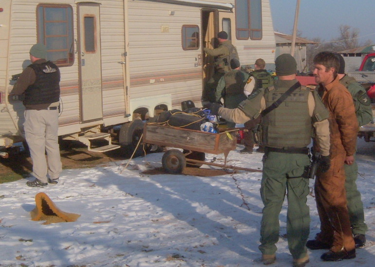 OBN officers serve an arrest warrant in Lindsay in December 2013 related to a probe into distribution of Mexican meth.