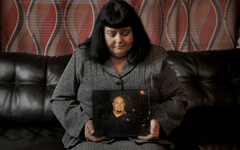 Michelle Casson of Del City holds a photo of her son Sashawn Saatian, who died from a drug overdose last year.