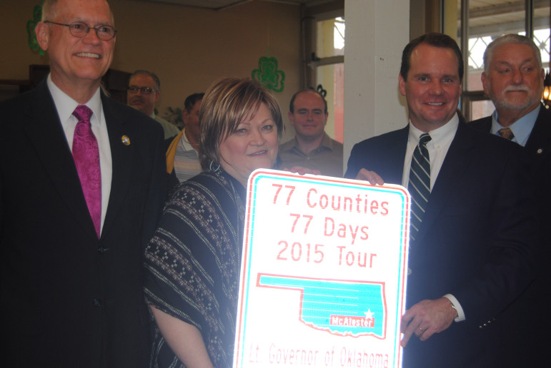 Lt. Gov. Todd Lamb (center right) receives a sign presented by the city commemorating his recent 77-county tour. McAlester Mayor Steve Harrison (left), city grant writer Pam Kirby and state Sen. Larry Boggs, R-Red Oak (right), were on hand.