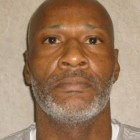 John M. Grant was convicted of stabbing a prison cafeteria worker to death.