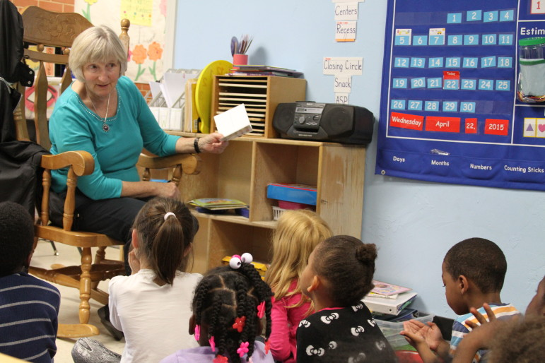 A volunteer at Positive Tomorrows, an Oklahoma City school for homeless children, reads stories to students there.