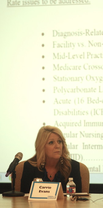 Oklahoma Health Care Authority Carrie Evans listens to a speaker during a public hearing held by the agency Thursday.