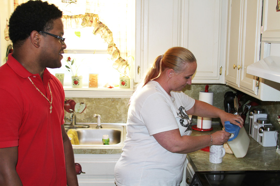 Letha Bartell and her fiancé, Davin Miller, make coffee in their southeastern Oklahoma City home. Bartell believes race has been a factor in the discipline of her 9-year-old son, who is in special education. Her son is half black.