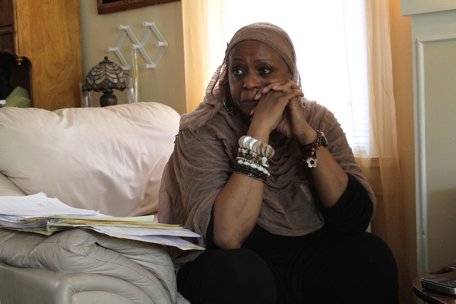 Karen Burston cries in her Oklahoma City home as she talks about the discrimination she believes she and her son have faced at Oklahoma City Public Schools. Burston's son is in a special education program at Sequoyah Elementary School.