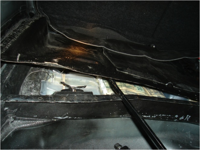The Oklahoma Bureau of Narcotics and Dangerous Drugs uses this image as an example of money the agency found hidden in the panel of a car and seized.