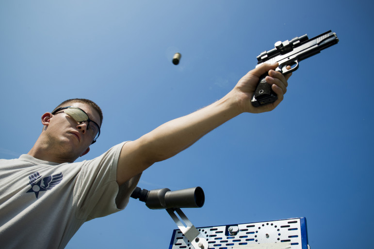 U.S. Air Force Staff Sgt. Jeremiah Jackson fires a round from a .45-caliber pistol in Valdosta, Ga., in August 2014.