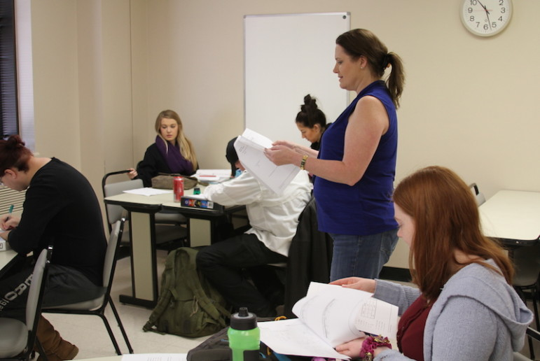 Professor Anne Fischer, center, leads a remedial math course at Tulsa Community College. Fischer said too many high school graduates come to her with a fear of math, and are unprepared for college-level classes.