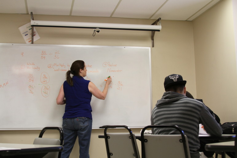 Anne Fisher leads a remedial math study session at Tulsa Community College as students prepare for a final last December. TCC is among several universities and colleges in Oklahoma revamping remedial courses in math and English in order to improve student completion rates.