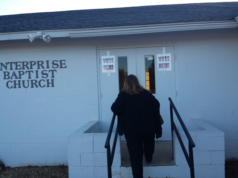 A voter enters the polling station at the Enterprise Baptist Church in rural Norman, Oklahoma. The state's polling stations will be open from 7 a.m. to 7 p.m. by state law.