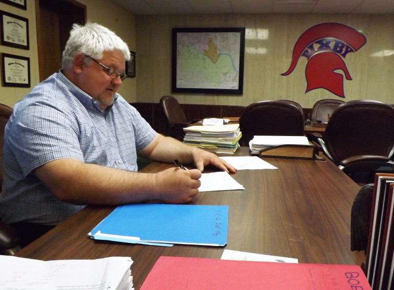 Superintendent Kyle Wood oversees Bixby Public Schools, which expanded its school year in 2010 but will roll bacm that increase this year because of budget cuts.