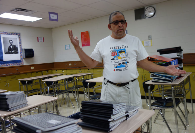 Tulsa high school history teacher Vince Facione expected to spend at least $300 before the first day of school. He gives each of his 190 students a three-ring binder.