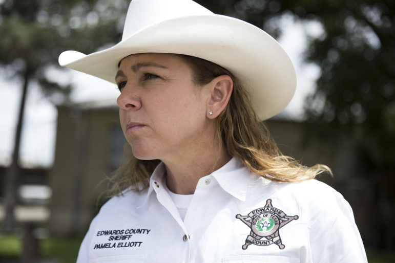 Edwards County Sheriff Pamela Elliott talks about elections and voter intimidation outside of her office in Rocksprings, Texas. A handful of Rocksprings residents claim the sheriff was intimidating voters by placing deputies at polling locations, but Elliott said she had permission from the election judge.