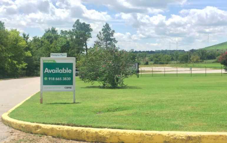 A for sale sign beckons buyers to the 151,000 square-foot factory in Sapulpa.