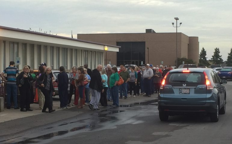 A line of early voters extended halfway around the Cleveland County Election Board building Thursday morning (above). The line was even longer Friday morning.
