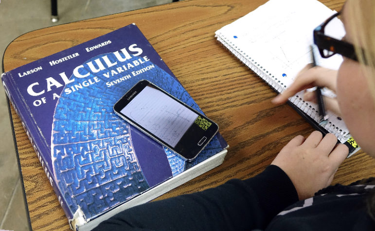 Senior Alexa Ostmeyer, 18, does classwork during an AP calculus class at Cushing High School.