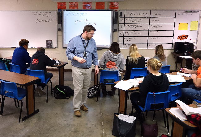 Jimmy Hartford teaches an AP calculus class to 10 students at Cushing High School.