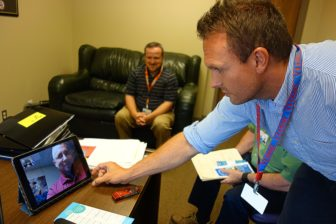 Josh Cantwell, of the Grant Lake Mental Health Center, places a Facetime video call to a mental health worker at the Vinita intensive outpatient center.