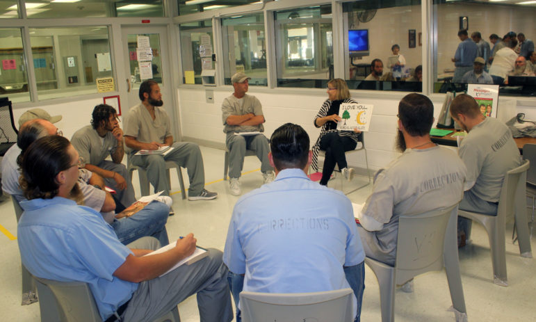 Cheri Fuller, executive director of OK Messages Project, gives tips to inmates at Joseph Hart Correctional Center in Lexington before they record videos to send to their children.