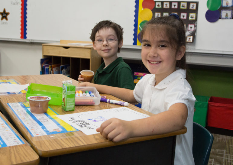 Districts with a significant population of low-income students are eligible for expanded meal programs, such as Breakfast in the Classroom. Shown is Tammera Williams (left) and Ella Quintanar (right) at Remington Elementary in Tulsa.