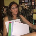 Erin Taylor - seated with paperwork