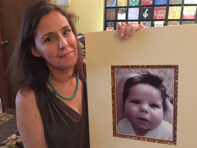 Erin Taylor with a portrait of her son